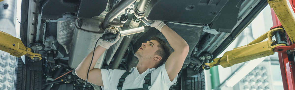 Mechanic servicing a vehicle - Car Servicing Whitby